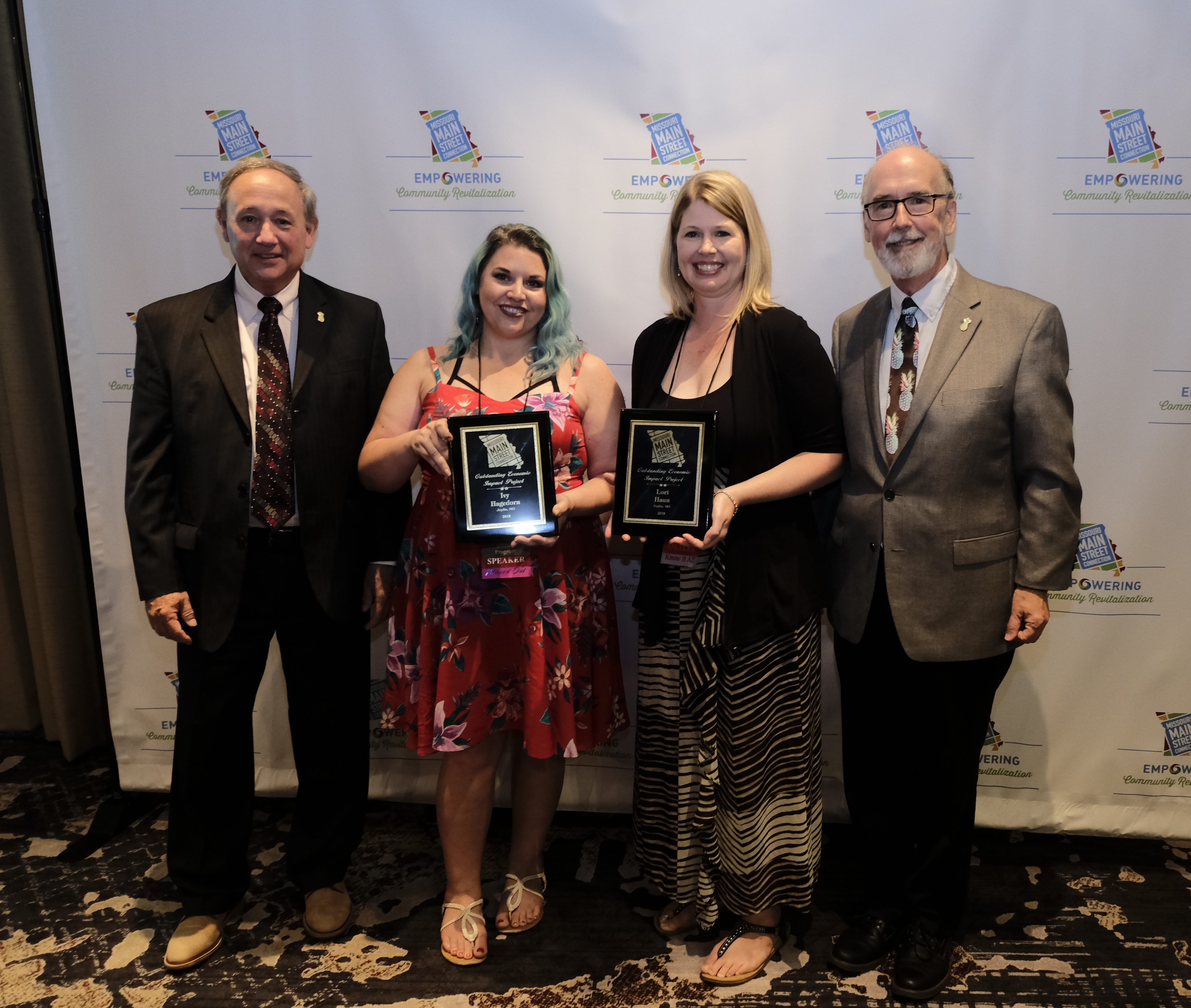 Image of Ivy Hagedorn and Lori Haun holding a Missouri Main Street Connection award
